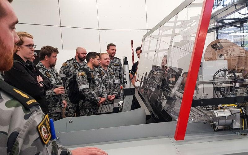 defence-tour-komax-machine-tour