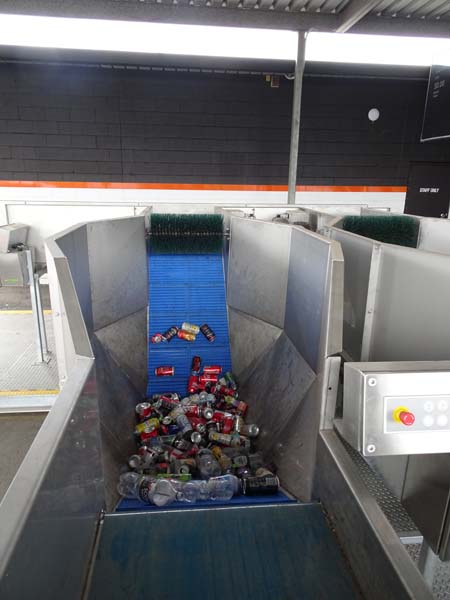 automatic sorting begins with separating containers on a conveyor line